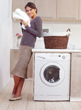 Woman on washing machine. In kitchen Royalty Free Stock Image
