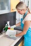 Woman washing plate Stock Photo
