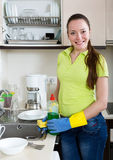 Woman washing plates in home Royalty Free Stock Photography