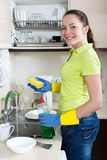Woman washing plates in home Royalty Free Stock Images