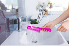 Woman washing up in the morning Stock Image