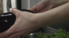 Woman Washing Vegatables Under Running Water. Young Woman Washing Vegatables Under Running Water Close Up stock footage