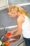Woman washing vegetables Stock Photography
