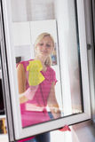 Woman washing the window glass royalty free stock photography