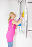 Woman washing the window glass Royalty Free Stock Images