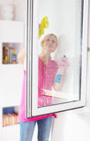 Woman washing the window glass Stock Photo