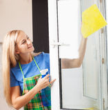 Woman washing window Royalty Free Stock Photo