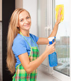 Woman washing window Royalty Free Stock Photography