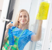 Woman washing window. Housewife cleaning window at home. Housework Royalty Free Stock Photos