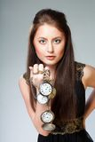 Woman with watch Stock Photos