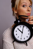 Woman with watch Stock Photo