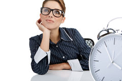 Woman with watch in the office Stock Photos