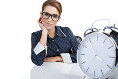 Woman with watch in the office Royalty Free Stock Images