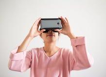 Woman watch though virtual reality device Stock Image