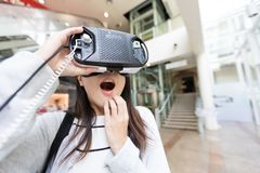 Woman watch with virtual reality and feeling surprise. Asian young pretty woman at outdoor Royalty Free Stock Photography