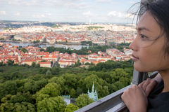 Woman watches cityscape of Prague Royalty Free Stock Photography