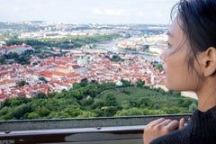 Woman watches cityscape of Prague Stock Photos