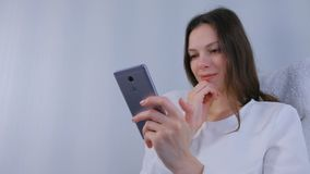 Woman watches funny video on mobile phone. Woman watches funny video on mobile phone stock video