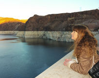 A Woman Watches a Sunset Over Lake Mead royalty free stock photography