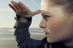 Woman looking out to sea Royalty Free Stock Images