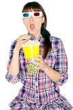 Woman watching 3D movie. A woman eating popcorn watching a 3D movie Royalty Free Stock Photography