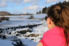 Woman watching beautiful frozen rapids Stock Photos