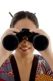 Woman watching through binocular Royalty Free Stock Image