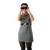Woman watching through binoculars Royalty Free Stock Photo