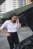 Woman watching car engine Royalty Free Stock Photo