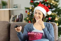 Free Woman Watching Christmas Tv Porgram At Home Royalty Free Stock Images - 127549759