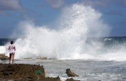 Woman Watching Crashing Waves Royalty Free Stock Photos