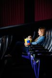 Woman Watching Film At Movie Theater Stock Photos