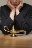Woman watching a genie lamp Royalty Free Stock Image