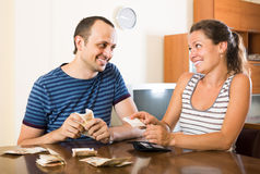 Woman watching her husband counting money Royalty Free Stock Image