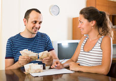 Woman watching her husband counting money Stock Photography