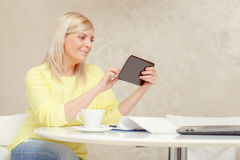 Woman watching at her tablet device Stock Image