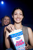 Woman watching a humorous film at the cinema Stock Photo