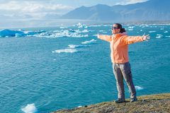 Woman watching icebergs. Iceland Stock Photos