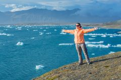 Woman watching icebergs. Iceland Stock Photo