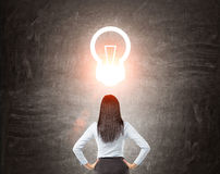 Woman watching at light bulb sketch Stock Photos