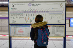 A woman watching the map at subway station in Kyoto Royalty Free Stock Photography