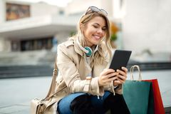 Woman watching media content in a digital tablet. Happy woman watching media content in a digital tablet Royalty Free Stock Images
