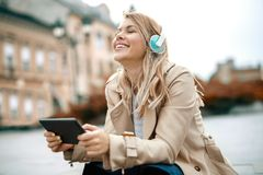 Woman watching media content in a digital tablet. Happy woman watching media content in a digital tablet Stock Photo