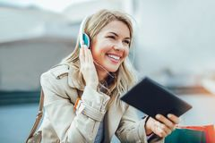 Woman watching media content in a digital tablet. Happy woman watching media content in a digital tablet Royalty Free Stock Image
