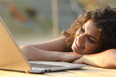Woman watching media in a laptop Royalty Free Stock Images
