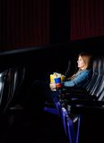 Woman Watching Movie At Cinema Theater Stock Photos