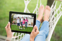 Woman Watching Movie On Digital Tablet Royalty Free Stock Photography