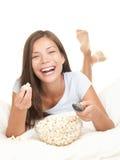 Woman watching movie laughing royalty free stock image