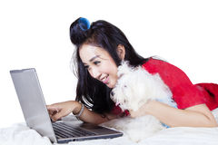 Woman watching a movie with Maltese dog Royalty Free Stock Photography