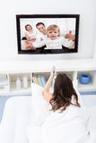 Woman watching movie on television Royalty Free Stock Images